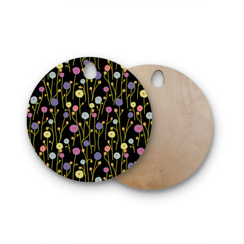 "Laura Nicholson ""Ranunculas On Black"" Yellow Floral Round Wooden Cutting Board"