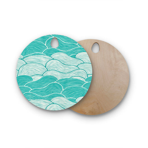 "Pom Graphic Design ""The Calm and Stormy Seas"" Green Teal Round Wooden Cutting Board"