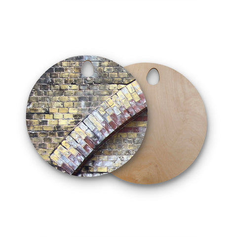 "Susan Sanders ""Painted Grunge Brick Wall"" Grey Yellow Round Wooden Cutting Board"