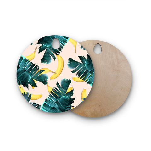 "83 Oranges ""Banana Leaves & Fruit"" Green Pastel Mixed Media Round Wooden Cutting Board"