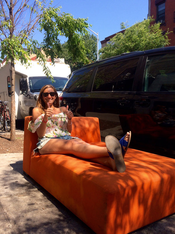 Girl on Orange Couch