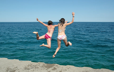 Girls Jumping into Water