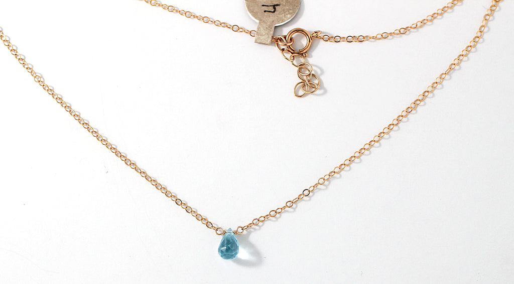 blue topaz and gold chain pendant by delia langan jewelry