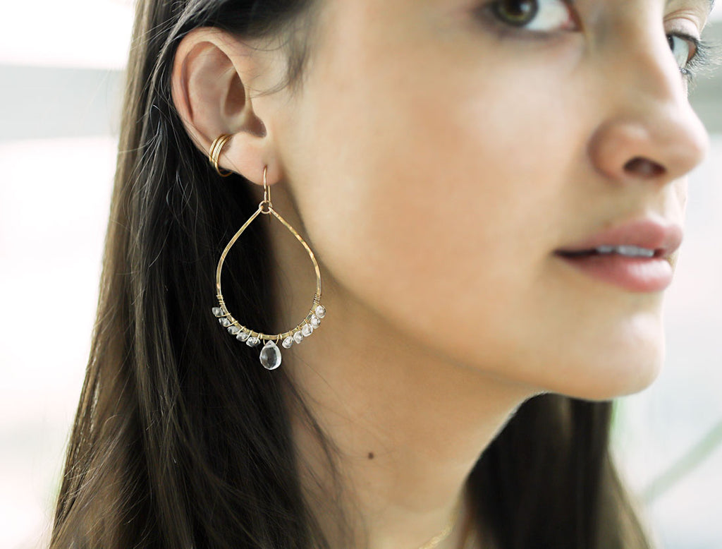 crystal quartz and gold arc earrings by delia langan jewelry