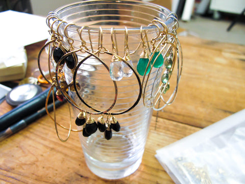 hanging earrings from cups easy DIY at home solutions for jewelry storage or jewelry storage while on the road