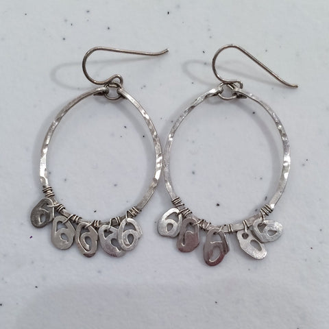 Clean sterling silver earrings by delia langan jewelry