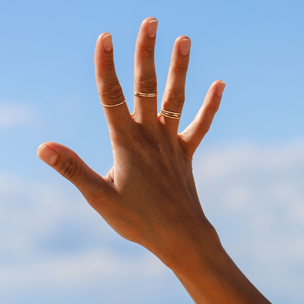 hand in sky with rings