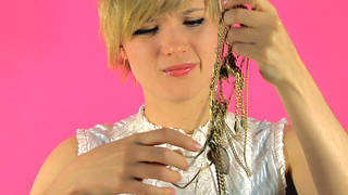 sad lady detangling jewelry