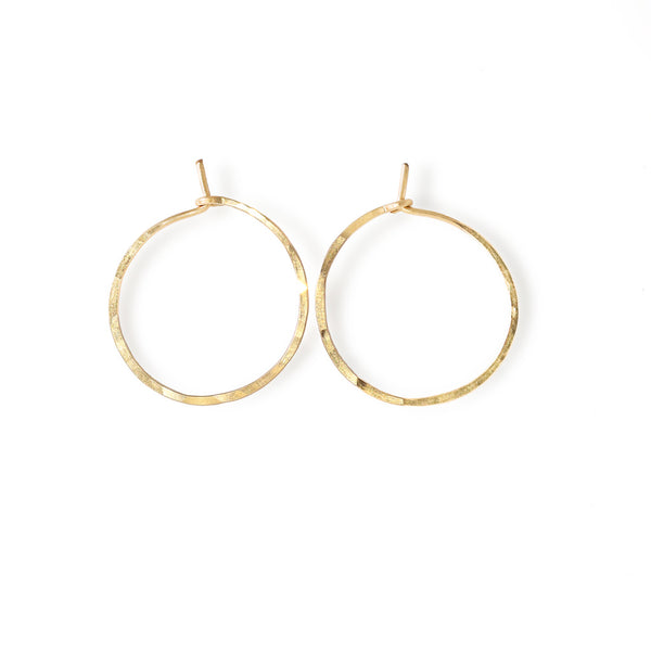 14k gold filled endless thin hoop earrings on white surface