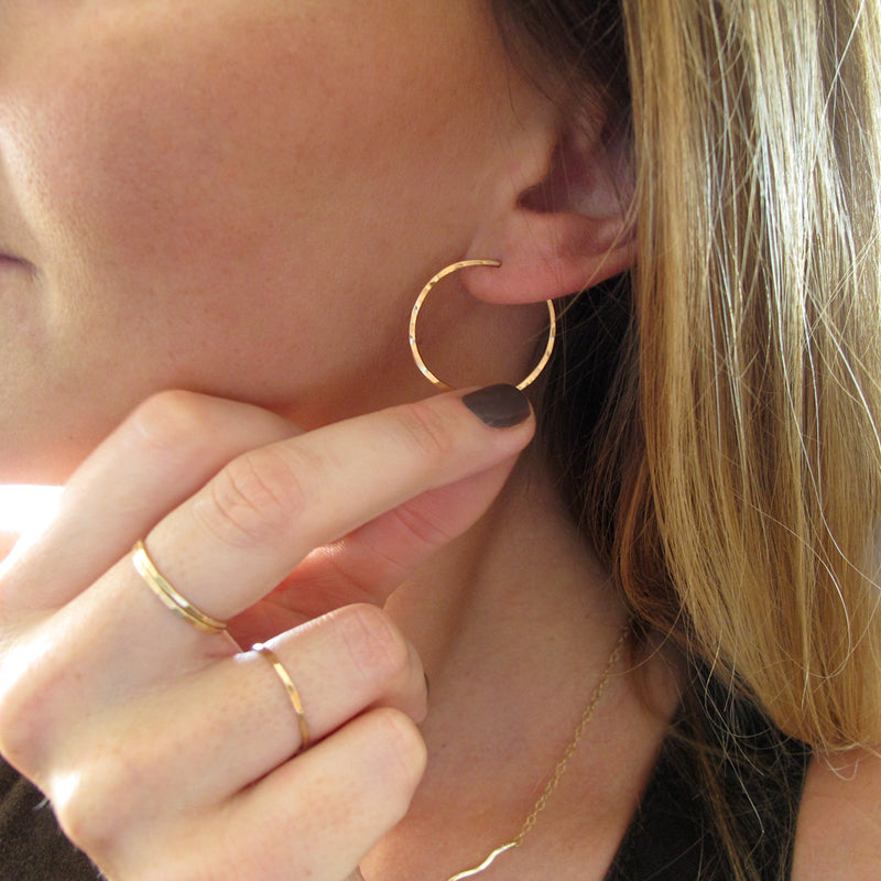 "1"" diameter thin gold hoop earrings on ear"