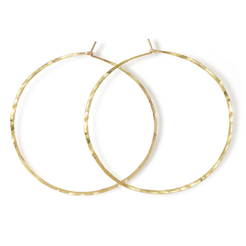 14k gold filled 2.5 inch endless thin hoop earrings on white surface
