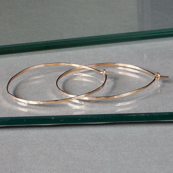 flat hammered gold hoop earrings by delia langan jewelry