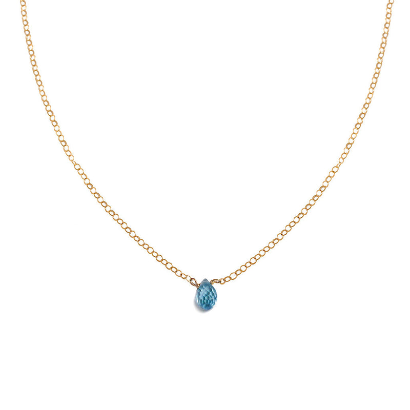 delicate blue topaz necklace on gold chain