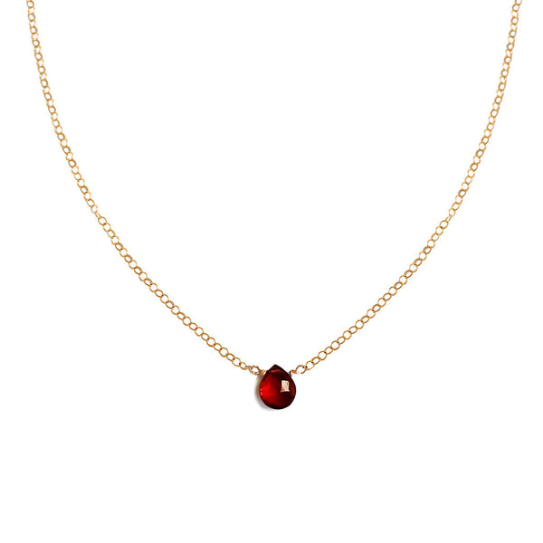 dainty garnet pendant on delicate gold chain