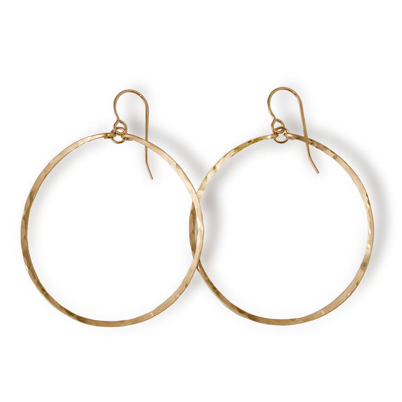 14k gold filled large round hoop earrings on a white surface