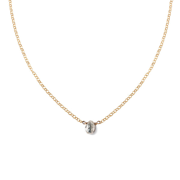 dainty silver pyrite necklace on delicate gold chain