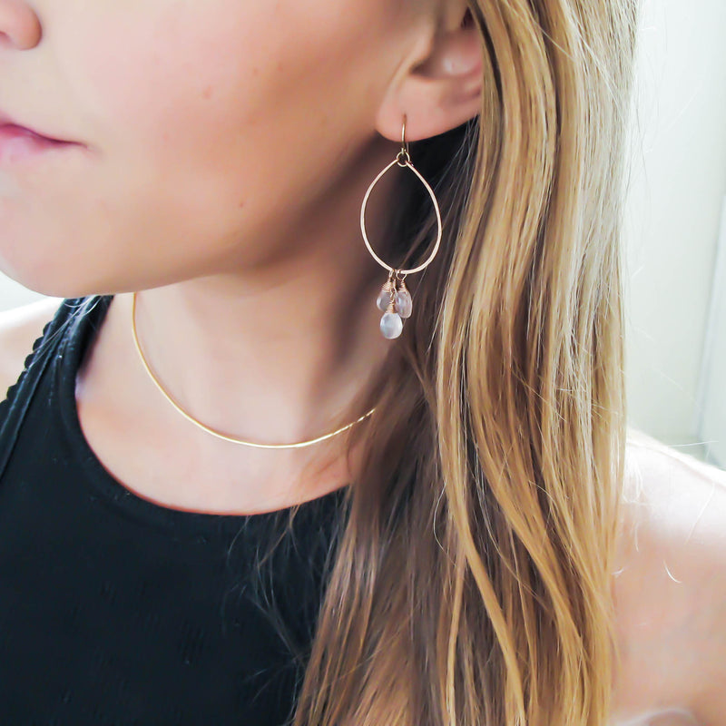 blond woman wearing rose gold filled rose quartz pure material gemstone hoops