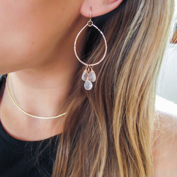 blond woman ear closeup wearing rose gold filled rose quartz pure material gemstone hoops