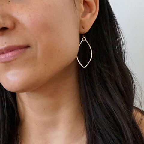 small leaf shaped earrings by delia langan jewelry