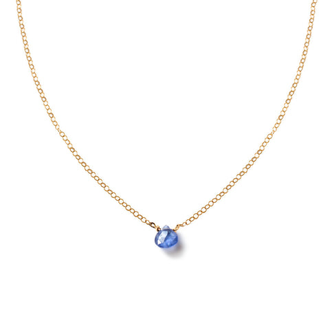 purple tanzanite gemstone on gold chain necklace by delia langan jewelry