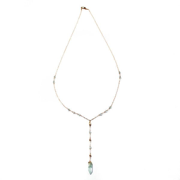 14k gold filled aquamarine y gemstone necklace on a white surface