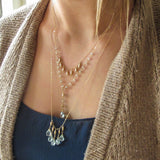 Layered pale blue aquamarine and gold necklaces layered delia langan jewelry necklaces