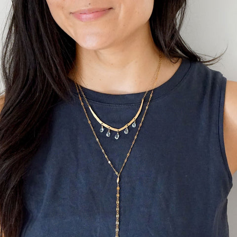 aquamarine flight necklace and gold sequin y necklace by delia langan jewelry