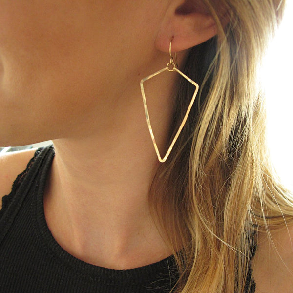 blond woman on a black tank wearing 14k gold filled arrowhead hoop earrings
