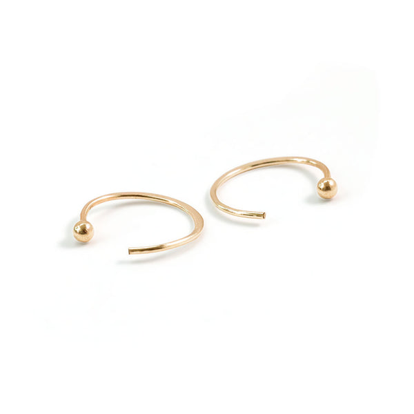 tiny gold ball end hug hoops on white background