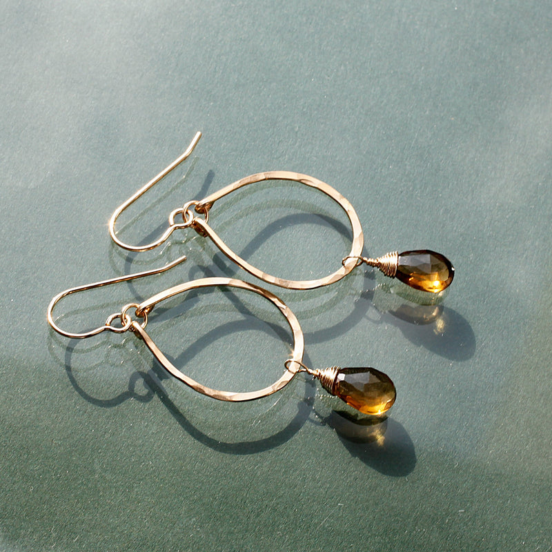 side view of beer quartz and gold teardrop earrings by delia langan jewelry