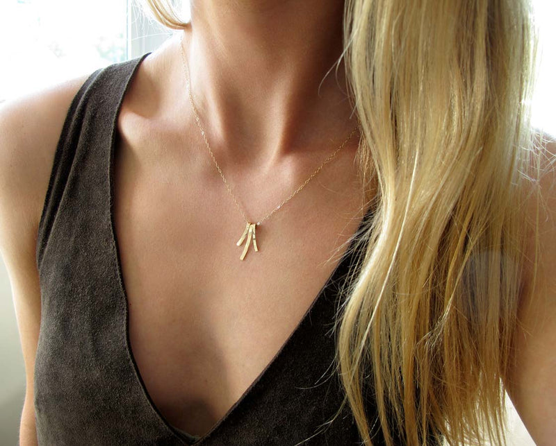 delicate gold fringe pendant by delia langan jewelry