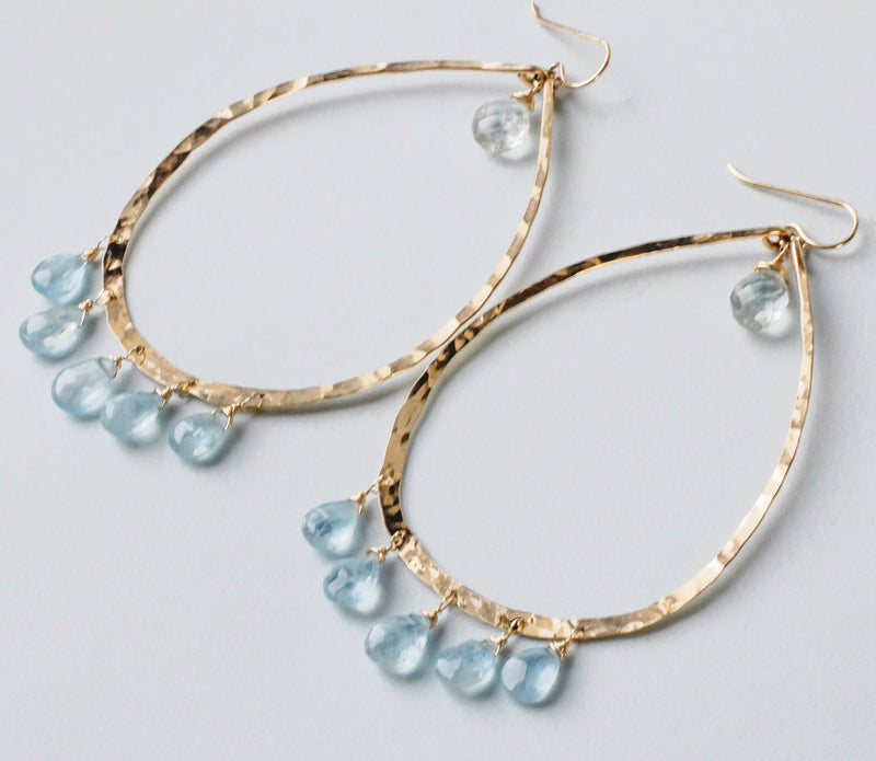 14k gold filled blue aquamarine chandelier gemstone hoops on grey surface