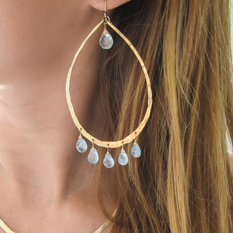 blond woman neck closeup wearing 14k gold filled blue aquamarine chandelier gemstone hoops