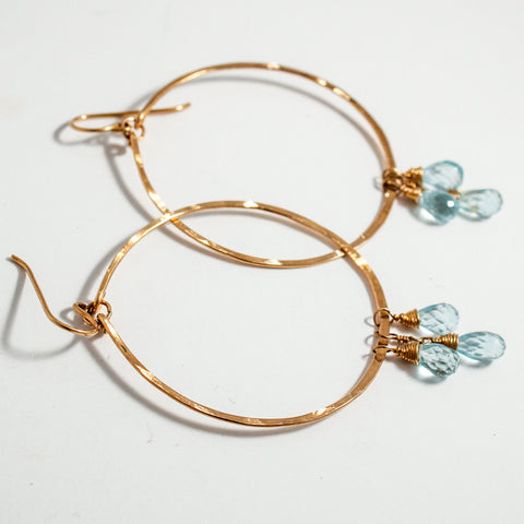 blue topaz and 14k gold filled hammered hoop earrings by delia langan jewelry
