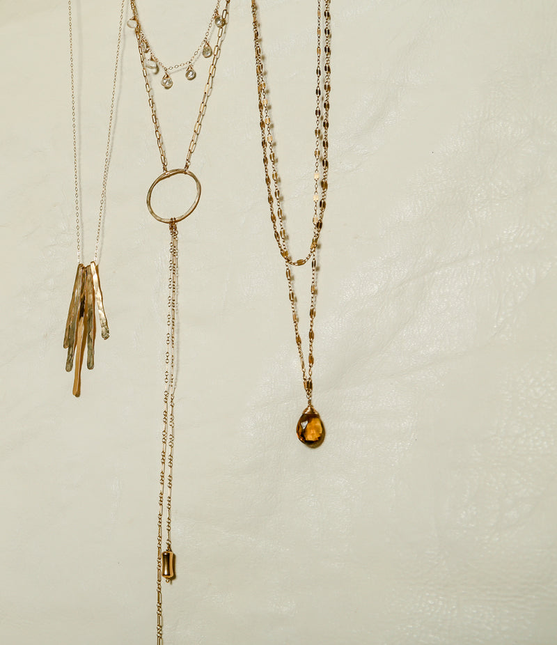 gold layering necklaces by delia langan jewelry