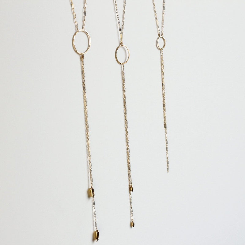 "three gold y shaped necklaces with circles ""bolo necklaces"" by delia langan jewelry"