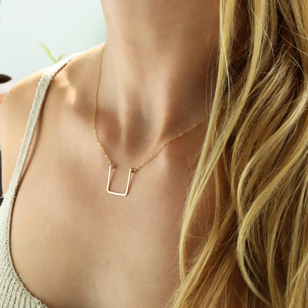 neckline with delicate geometric hammered pendant
