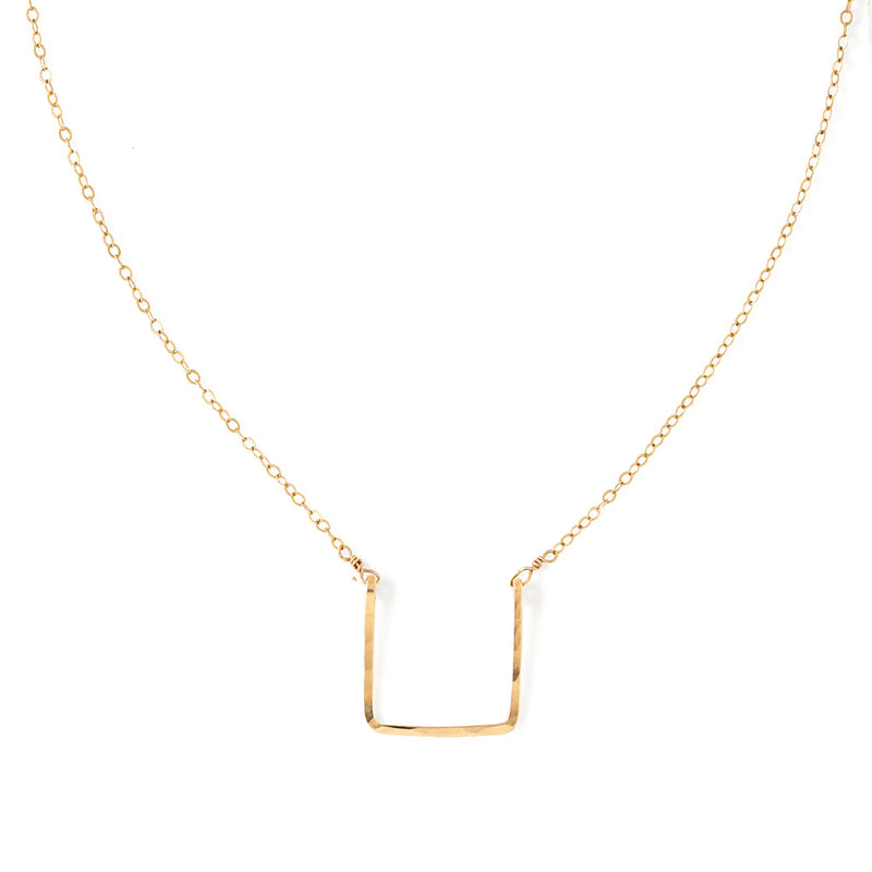 14k gold filled brick necklace on a white surface