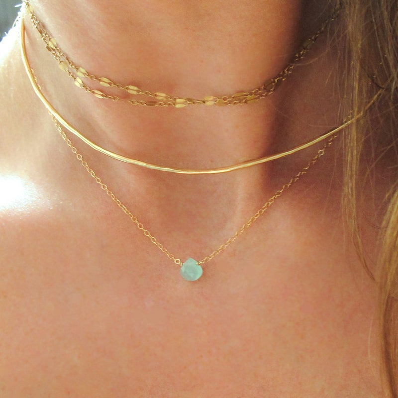 layered gold choker necklaces and small chalcedony pendant