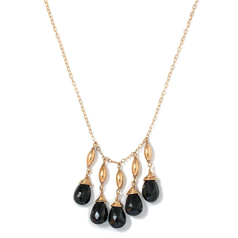 14k gold filled black spinel cascade gemstone necklace on white surface