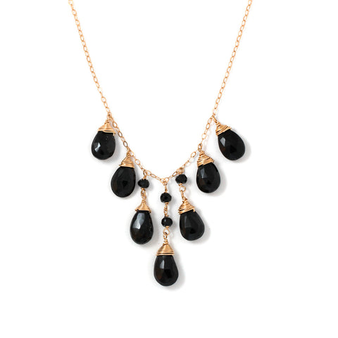 black spinel and gold necklace by delia langan jewelry