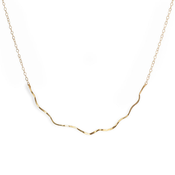 14k gold filled coastal route necklace on a white surface