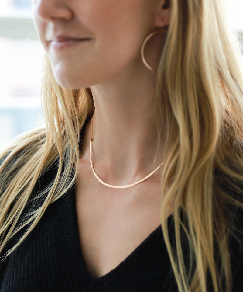 girl with rose gold collar necklace