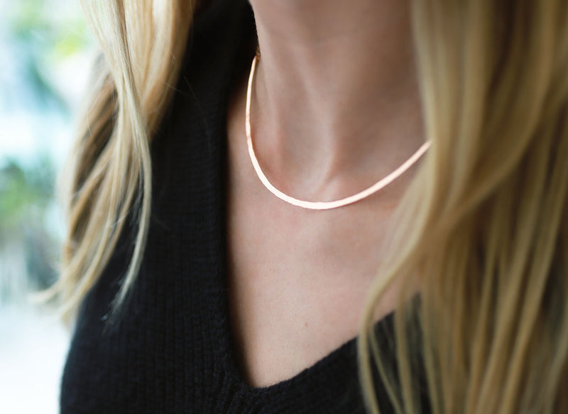 closeup of neckline with gold collar necklace