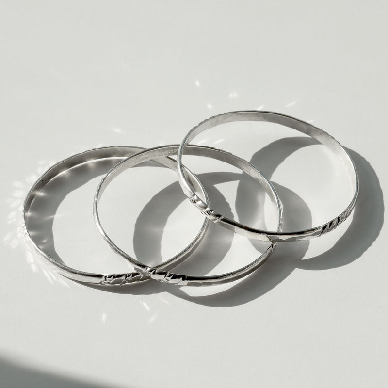 three silver bangles by delia langan jewelry