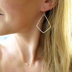 delicate geometric gold dangle earrings by delia langan jewelry