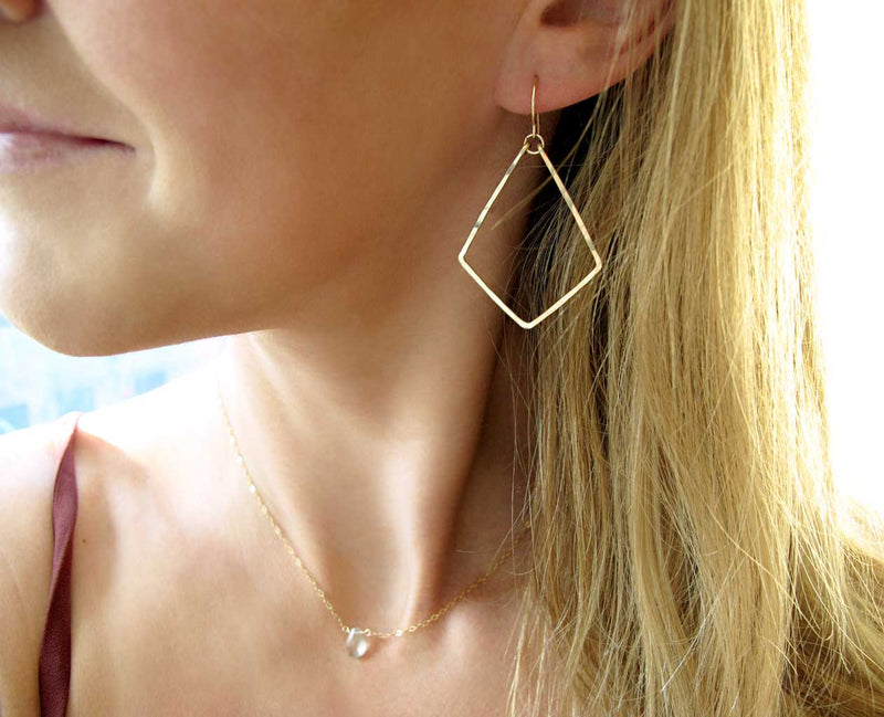 dainty geometric gold dangle earrings by delia langan jewelry