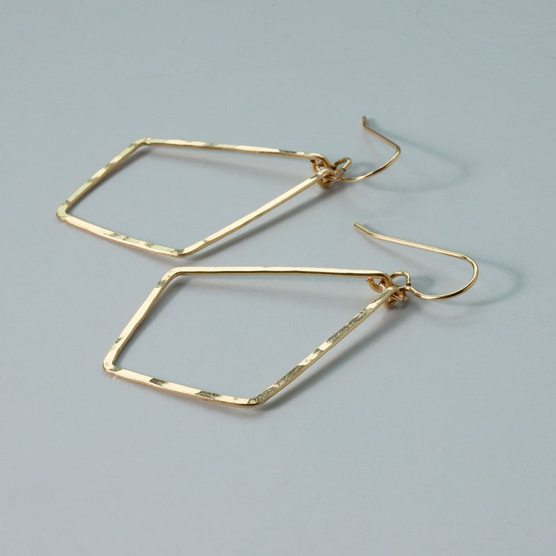 14k gold filled four corner hoop earrings on grey surface