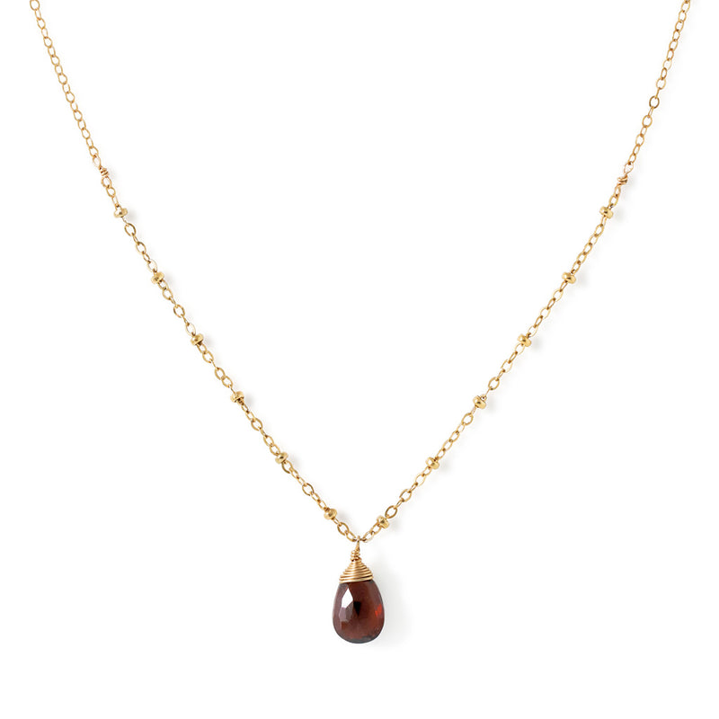 delicate gold and garnet pendant by delia langan jewelry