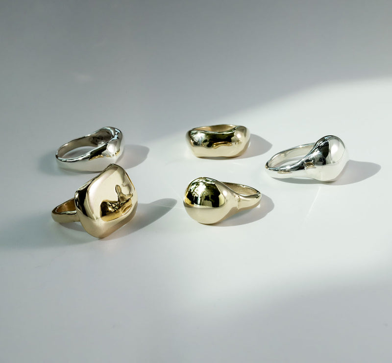 gold and silver statement rings by delia langan jewelry